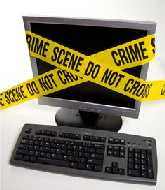 a desk top computer taped up with crime scene tape