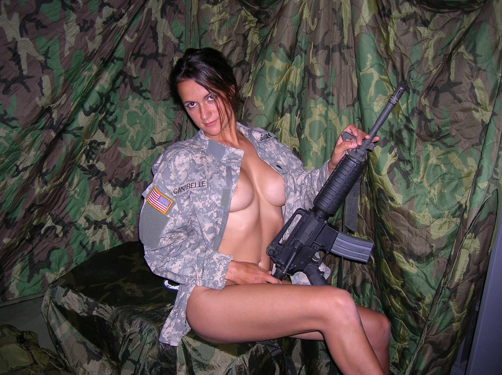 Armed soldier pretty naked woman rifle stock photo