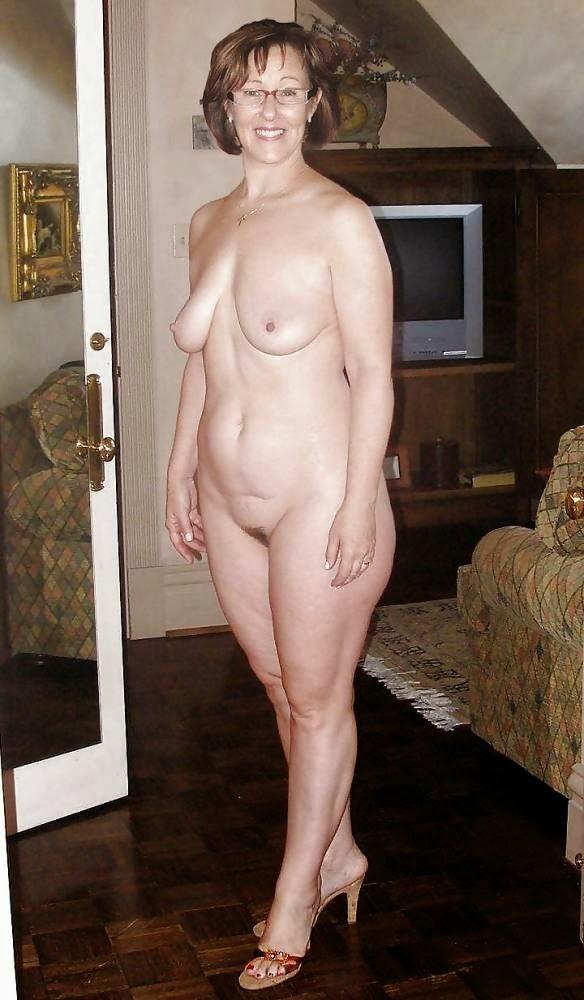 Sexy bikini girl oiling body