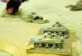Sherman's turn to attack the flanking force - one of their number burns in the background