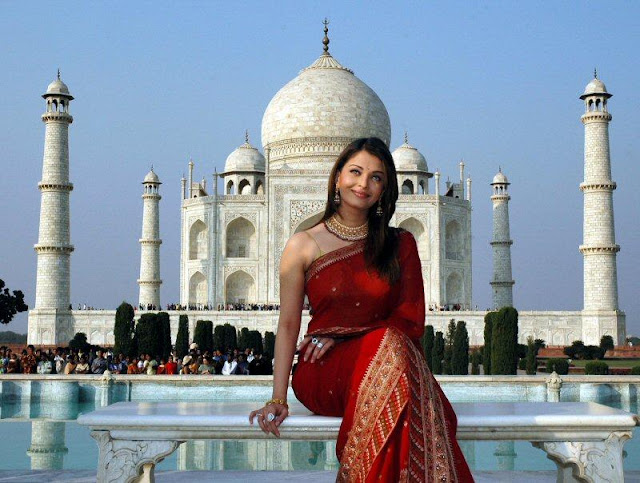 Miss World and queen of hearts - Aishwarya Rai poses in front of Taj Mehal in a red Saree