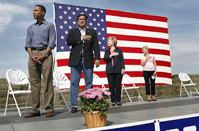Barack Hussein Obama refuses to place his hand over his heart to pledge allegiance to the United States of America.  See the original photo in Time Magazine.  Check it out on Snopes.  It's true.