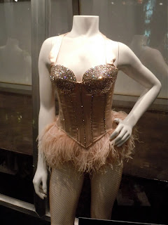 They are the original costumes from the hit musical  Burlesque  and are displayed at the Arclight Hollwood Cinema. The costumes were designed by Micheal ... & Aguilera Updates: Burlesque Costumes