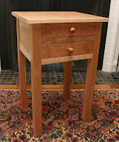 Woodworking beats home improvement any day... one of my two new curly cherry nightstands.