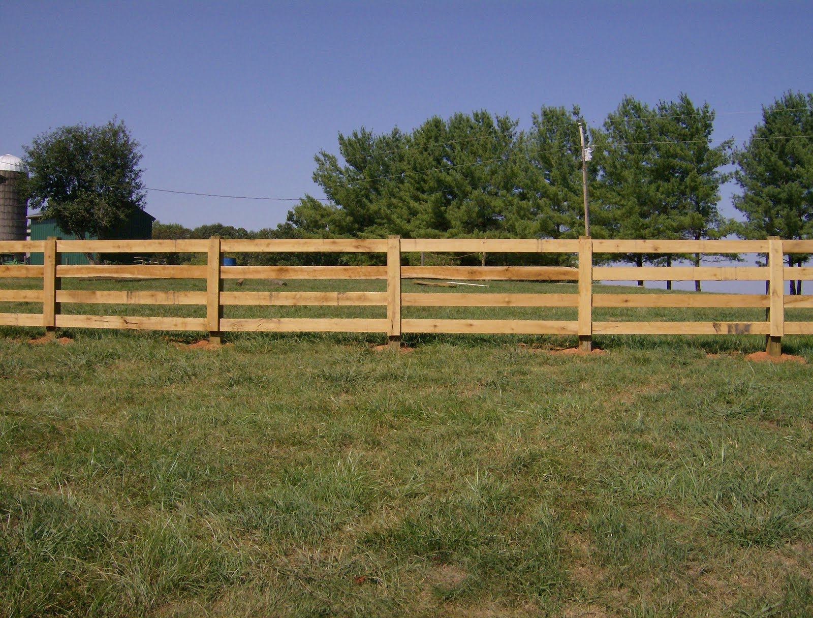 Image of Wooden paddock fence post with barbed wire on top ...