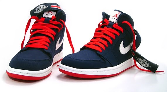 This Air Jordan 1 High Strap is covered in a midnight navy canvas which is  accented with a sail Nike Swoosh. Hits of red are added to the outsole 56cb6e8b3