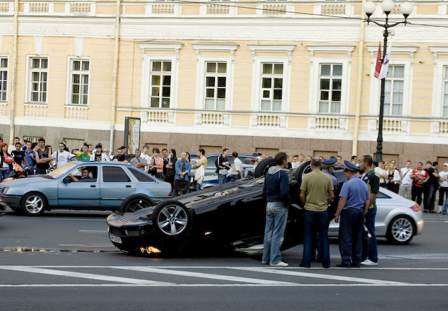 Russian driver manage to tip over his sparkling new E92 BMW 330i Coupe?