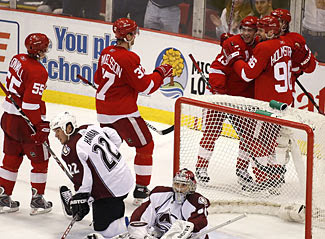 Red Wings celebrate the eventual game winner against the Avalanche