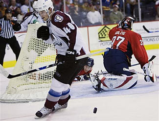 Marek Svatos of the Colorado Avalanche gets one past Olaf Kolzig