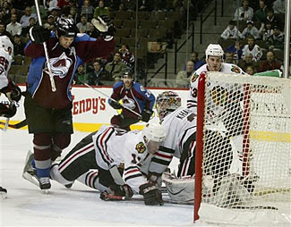 Ian Laperriere of the Colorado Avalanche celebrates a goal against the Chicago Blackhawks