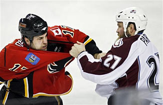 Scott Parker of the Colorado Avalanche squares off with Eric Godard of the Calgary Flames