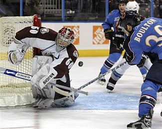Jose Theodore of the Colorado Avalanche makes a save in a game against the Atlanta Thrashers
