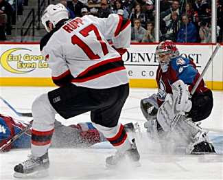 Jose Theodore of the Colorado Avalanche makes a save against Rupp of the New Jersey Devils