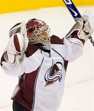 Jose Theodore celebrates a Colorado Avalanche win