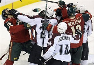 A scrum develops in front of Jose Theodore during Game 2 of the Colorado Avalanche - Minnesota Wild series