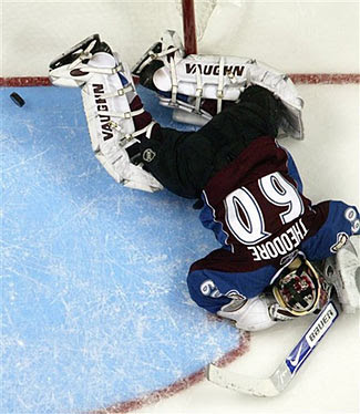Jose Theodore lies prone after a 2-on-1 gave the Minnesota Wild a 2-1 lead over the Colorado Avalanche