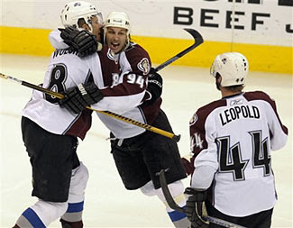 Andrew Brunette and Milan Hejduk of the Colorado Avalanche celebrate a goal against the Minnesota Wild