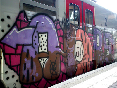 RAILROAD GRAFFITI A railcar in a dark rail yard provides a target for graffiti writers. Graffiti artists consider railcars the ultimate painting a traveling exhibition for talent and effort