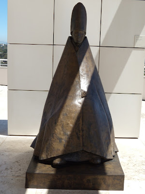 Seated Cardinal bronze sculpture at The Getty