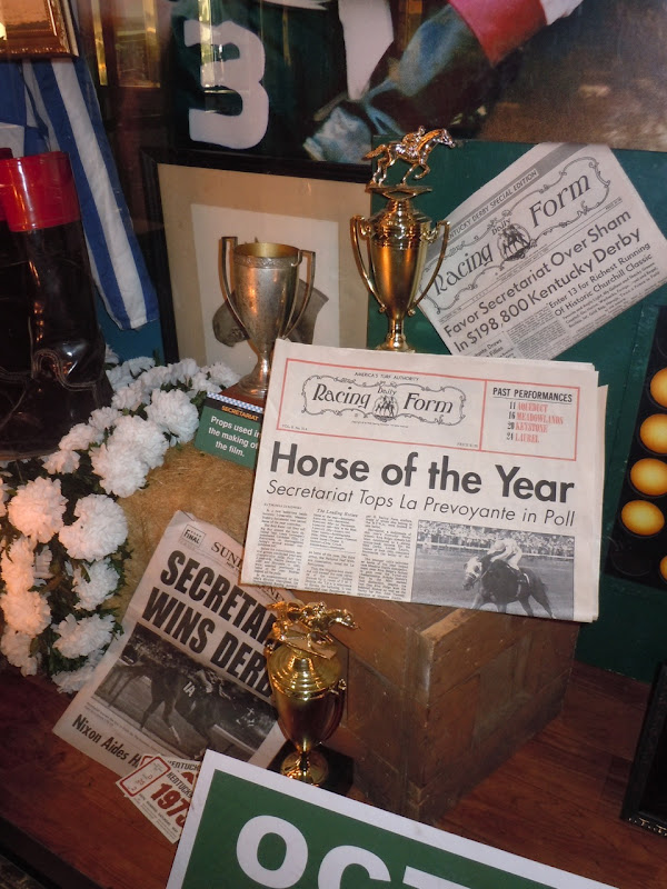 Secretariat trophy and newspaper props