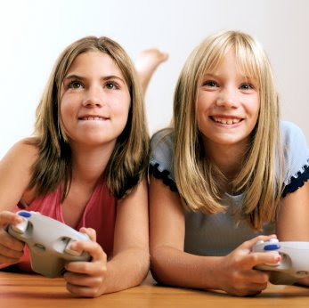 two girls play video games in a NAMC montessori home