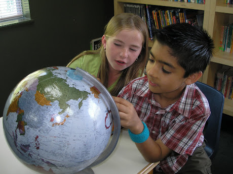 boy and girl with globe Second Plane of Development Ages 6-12 NAMC Montessori Philosophy