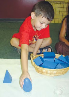 NAMC montessori parenting full time or part time preschool boy playing with geometric solids