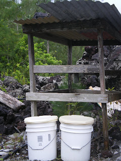 an outdoor permaculture toilet; two buckets.