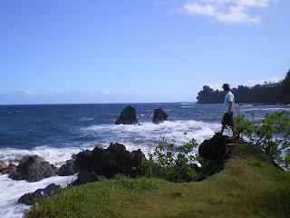 Standing on a rock near the ocean in Hawaii