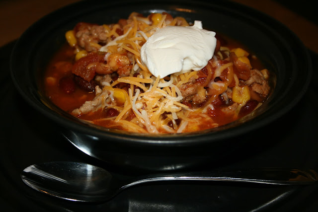 This is the Original Taco Soup Recipe from the A Year of Slow Cooking website (crockpot 365). Taco seasoning, ranch seasoning, canned beans, canned corn, ground meat -- I've made this SO MANY times!