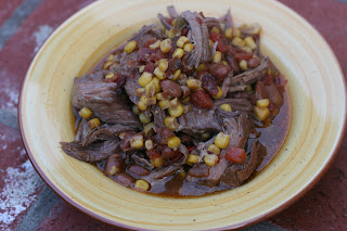 Tex Mex Pot Roast in the Slow Cooker: chili beans, rotel, corn, chipotle chili powder -- easy way to use up a frozen and forgotten roast!
