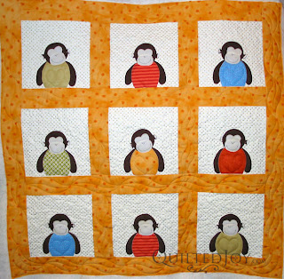Anna's Monkeys quilt with custom quilting by Angela Huffman - QuiltedJoy.com