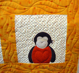 Angela added a heart to each appliqued monkey - QuiltedJoy.com