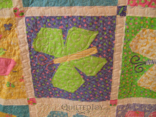 Angela added accents to the wings and an elliptical body to each butterfly - QuiltedJoy.com
