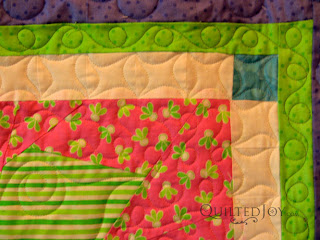 Angela added line dancing to accent the piecing in the sashing - QuiltedJoy.com