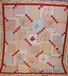 Pretty Posies pantograph on Joan's Layer Cake quilt - QuiltedJoy.com