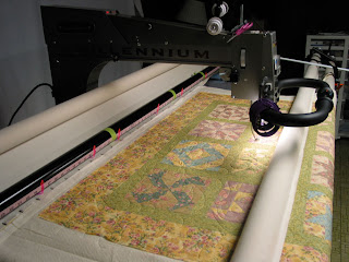 Sleepy Field of Flowers quilt with a soothing watercolor palate