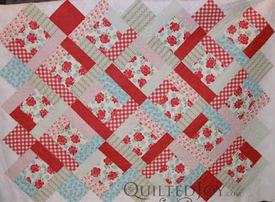 Stripey dotted roses quilt, quilted by Angela Huffman