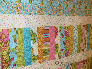 Spin Pantograph - Jelly Roll Pickety Sticks, quilted by Angela Huffman