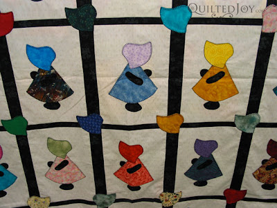 Love the little hats in the sashing of this Sunbonnet Sue quilt! - QuiltedJoy.com