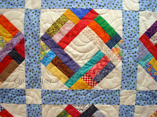 A Scrap Basket quilt with Spirals pantograph. Longarm quilting by Angela Huffman - QuiltedJoy.com