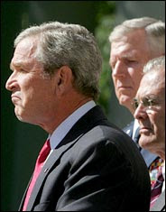 Bush looks very Chimp-like again. Rumsfeld and Myers wonder what to do. (See www.bushorchimp.com)