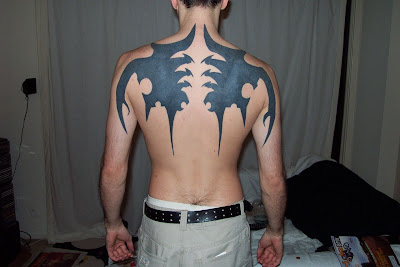 wings  tribal  tattoos on back-434