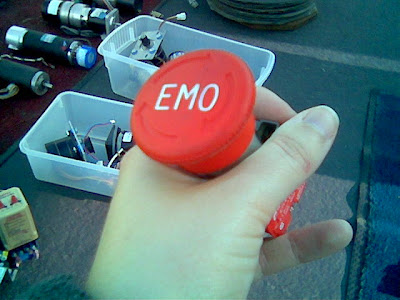 mysterious EMO button. Is it something you press to alert the lab to the presence of an emo kid?