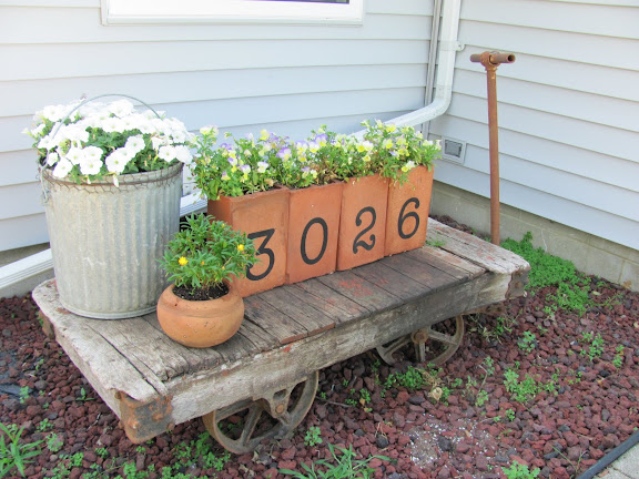 House number brick planters for a garden feature.