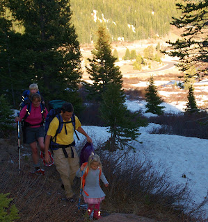 Family hiking to hut