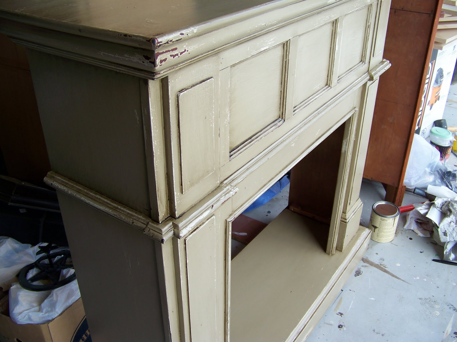 Check out this amazing before and after from new to antique...distressed fireplace mantel makeover