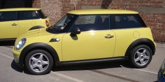 Yellow Mini One with star alloys