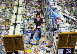 (c) BBC - Image of Gisborne library post-earthquake, with books scattered all over the floor