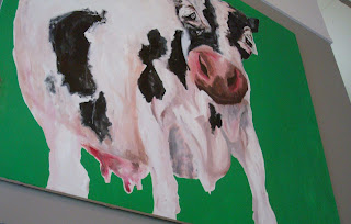 GBB artwork on the wall - a large cow surveying the beef-eating customers